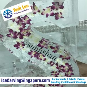 frozen flowers ice sculpture logo embedded ice sculpture